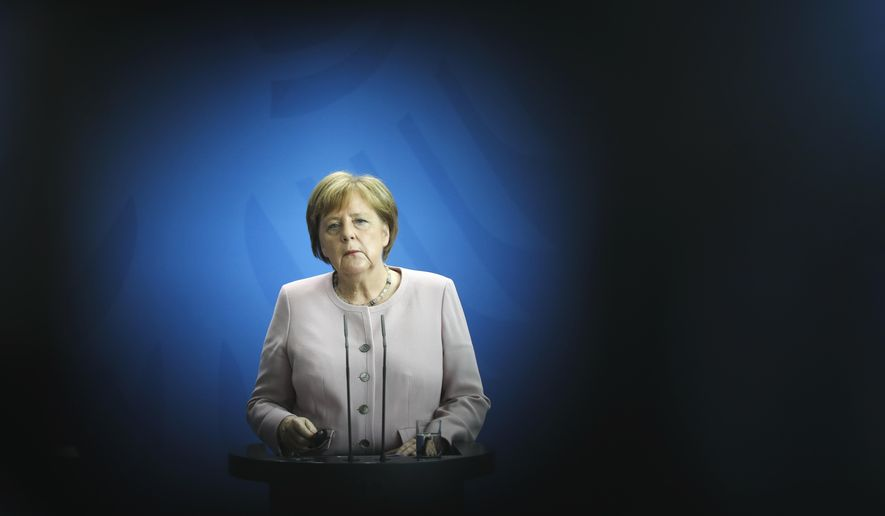 German Chancellor Angela Merkel attends a joint news conference with Ukrainian President Volodymyr Zelenskiy after a meeting at the chancellery in Berlin, Germany, Tuesday, June 18, 2019. (AP Photo/Markus Schreiber)