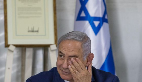 Israeli Prime Minister Benjamin Netanyahu convenes his Cabinet to inaugurate a new settlement named after President Donald Trump in a gesture of appreciation for the U.S. leader's recognition of Israeli sovereignty over the Golan Heights, Sunday, June 16, 2019. The Trump name graces apartment towers, hotels and golf courses. Now it is the namesake of a tiny Jewish settlement in the Israeli-controlled Golan Heights. (AP Photo/Ariel Schalit)