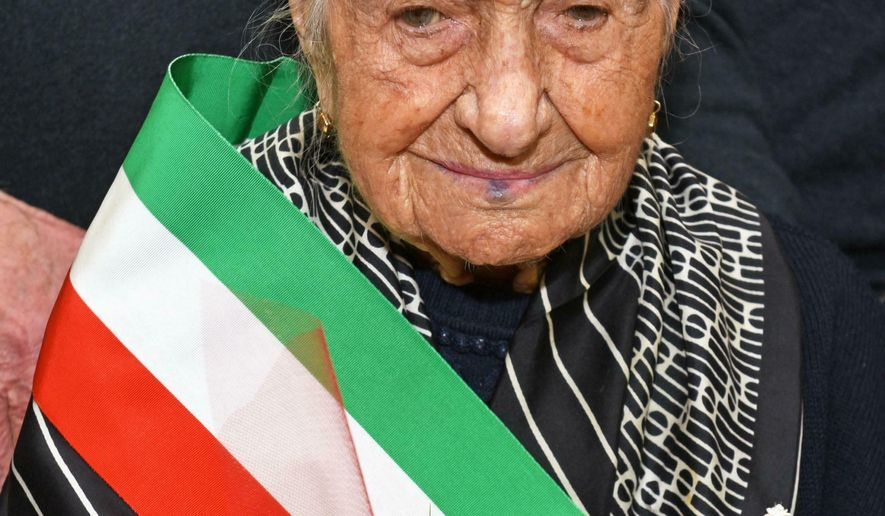 This photo taken on March, 19, 2018 shows Giuseppina Robucci from Poggio Imperiale, near Foggia, Southern Italy. A 116-year-old Italian woman who was the oldest person in Europe and the second-oldest in the world has died. The news agency ANSA said Giuseppina Robucci died Tuesday in the southern Italian town of Poggio Imperiale, where she was born on March 20, 1903. She lived 116 years and 90 days. Robert Young of the U.S.-based Gerentology Research Group said Robucci was the last European born in 1903. She was just two months younger than the current oldest living person, Kane Tanaka of Japan, born on Jan. 2, 1903. Robbuci is currently No. 17 on the list of people who lived the longest lives. (Franco Cautillo/ANSA via AP)