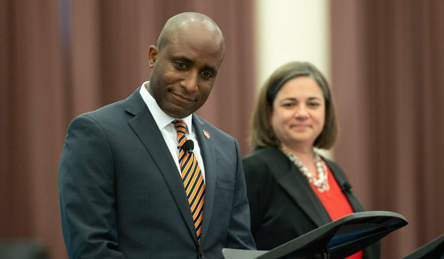 In a Saturday, June 8, 2019, photo, Kansas City mayoral candidates Jolie Justus, right, and Quinton Lucas meet at Northland Cathedral for the fifth of six debates sponsored by The Kansas City Star. (Shelly Yang/The Kansas City Star via AP) **FILE**