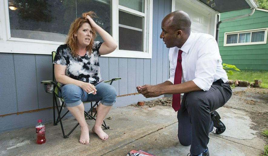 In a Thursday, May 30, 2019, file photo, Sonja Houston expressed dismay that someone dumped a large pile of trash in her yard to Kansas City mayoral candidate Quinton Lucas, who was going door-to-door in the Ruskin Heights neighborhood. Quinton faces Jolie Justus in the mayoral election Tuesday, June 18, 2019.  (Tammy Ljungblad/The Kansas City Star via AP) ** FILE **