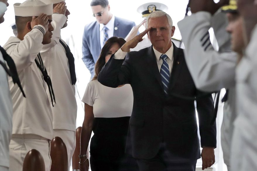 Vice President Mike Pence salutes as he boards the USNS Comfort, Tuesday, June 18, 2019, in Miami. The hospital ship is scheduled to embark on a five-month medical assistance mission to Latin America and the Caribbean, including several countries struggling to absorb migrants from crisis-wracked Venezuela. (AP Photo/Lynne Sladky)