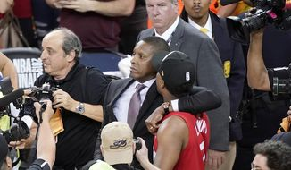FILE - This Thursday, June 13, 2019, file photo, Toronto Raptors general manager Masai Ujiri, center left, walks with guard Kyle Lowry after the Raptors defeated the Golden State Warriors in Game 6 of the NBA Finals in Oakland, Calif. An attorney for a deputy involved in an altercation with Ujiri as he tried to join his team on the court to celebrate their NBA championship, said his client suffered a concussion and is on medical leave. Attorney David Mastagni said Tuesday, June 18, 2019, the 20-year-veteran of the Alameda County Sheriff's Office has a jaw injury and is considering filing a lawsuit. (AP Photo/Tony Avelar, File)