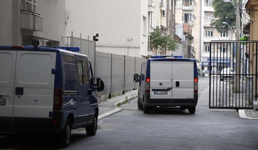 A detention vehicle is seen as it leaves a courthouse in Belgrade, Serbia, Tuesday, June 18, 2019. A Serbian court has acquitted a former U.S. Marine charged with illegal possession and distribution of weapons. The case of Daniel Corbett, reportedly a U.S. Navy SEAL reservist, has been in the focus of Serbian media since he was arrested in a Belgrade apartment along with three Serbs in January last year. (AP Photo/Darko Vojinovic)