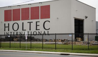 The exterior of a Holtec International facility in Camden, N.J., is shown Tuesday, June 18, 2019. A New Jersey state task force found private stakeholders, particularly those linked to an influential Democratic fundraiser and business executive in southern New Jersey, helped craft tax credits to benefit their business interests. The report says that EDA failed to conduct a simple internet search, which would have revealed that Holtec was barred from doing business with the Tennessee Valley Authority briefly in 2010. Any such so-called debarment would have been grounds for Economic Development Authority, to deny Holtec's award application, the report said. (AP Photo/Matt Rourke)