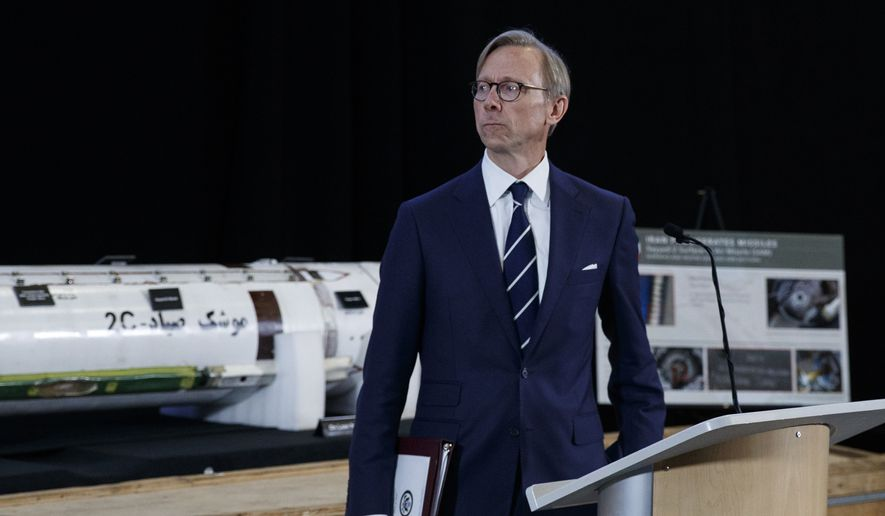 """Brian Hook, U.S. special representative for Iran, pauses in front of a Surface to Air Missile (Sayyad 2C) at the Iranian Materiel Display (IMD) at Joint Base Anacostia-Bolling, in Washington, Thursday, Nov. 29, 2018. The Trump administration accused Iran of stepping up violations of a U.N. ban on arms exports by sending rockets and other weaponry to rebels in Afghanistan and Yemen. The presentation displays weapons and fragments of weapons seized in Afghanistan, Bahrain and Yemen that it said are evidence Iran is a """"grave and escalating threat"""" that must be stopped. (AP Photo/Carolyn Kaster) **FILE**"""