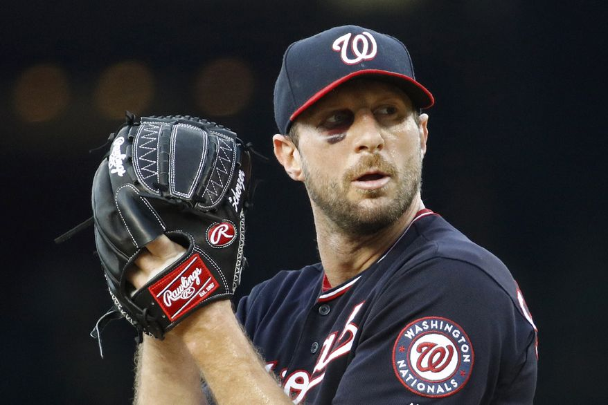 Washington Nationals starting pitcher Max Scherzer prepares to throw to the Philadelphia Phillies in the first inning of the second baseball game of a doubleheader, Wednesday, June 19, 2019, in Washington. (AP Photo/Patrick Semansky)