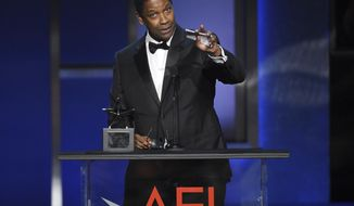 """FILE - In this  June 6, 2019, file photo, actor Denzel Washington addresses the audience during the 47th AFI Life Achievement Award ceremony honoring him in Los Angeles. The award-winning actor, director, and producer is the face of some of the most well-known films of the last few decades, including """"Fences,"""" """"Man on Fire,"""" """"Malcolm X,"""" and """"The Book of Eli."""" (Photo by Chris Pizzello/Invision/AP, File)"""