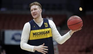 FILE - In this Wednesday, March 27, 2019 file photo, Michigan's Ignas Brazdeikis smiles while running through a drill during practice at the NCAA men's college basketball tournament in Anaheim, Calif. With only a few days remaining before the NBA draft, Iggy Brazdeikis enjoyed a reunion of sorts when he worked out for the Cleveland Cavaliers. That meant a chance to catch up with John Beilein. The NBA draft is on Thursday, June 20, 2019. (AP Photo/Jae C. Hong, File)