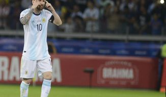 Argentina's Lionel Messi gestures during a Copa America Group B soccer match against Paraguay at the Mineirao stadium in Belo Horizonte, Brazil, Wednesday, June 19, 2019. (AP Photo/Eugenio Savio)