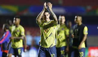 Colombia's James Rodriguez applauds to fans at the end of a Copa America Group B soccer match at the Morumbi stadium in Sao Paulo, Brazil, Wednesday, June 19, 2019. (AP Photo/Victor R. Caivano)