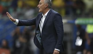 Brazil's coach Tite gives instructions to his players during a Copa America Group A soccer match against Venezuela at the Arena Fonte Nova in Salvador, Brazil, Tuesday, June 18, 2019. (AP Photo/Ricardo Mazalan)