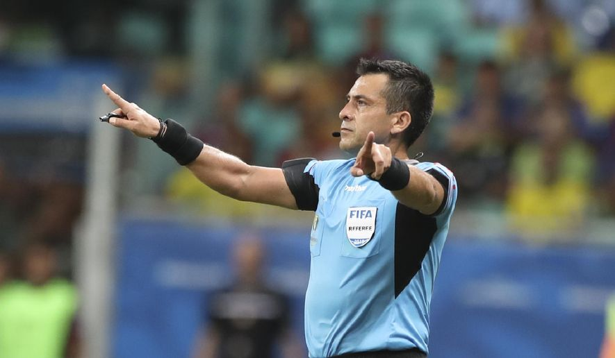 Referee Julio Bascunan disallows a goal scored by Brazil's Gabriel Jesus after consulting the VAR during a Copa America Group A soccer match at the Arena Fonte Nova in Salvador, Brazil, Tuesday, June 18, 2019. (AP Photo/Ricardo Mazalan)