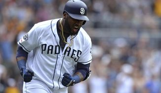 San Diego Padres' Franmil Reyes reacts after hitting a three-run home run during the seventh inning of a baseball game against the Milwaukee Brewers Wednesday, June 19, 2019, in San Diego. (AP Photo/Orlando Ramirez)