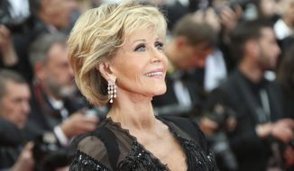In this May 13, 2018 file photo, actress Jane Fonda poses for photographers upon arrival at the premiere of the film 'Sink or Swim' at the 71st international film festival, Cannes, southern France. Jane Fonda is joining a group of Hollywood power players to host a fundraiser for Democratic presidential contender Steve Bullock. (Photo by Joel C Ryan/Invision/AP)