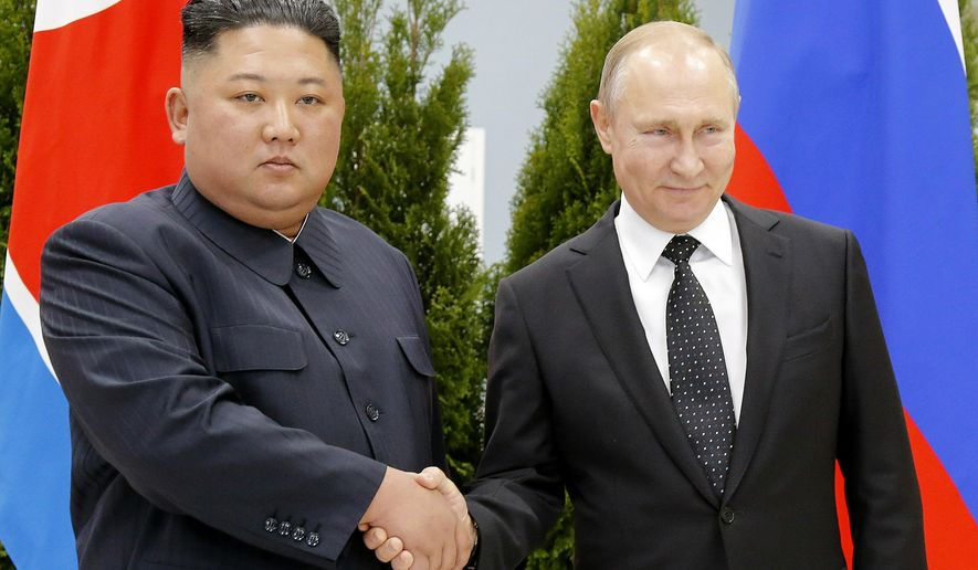 FILE - In this April 25, 2019 file photo, Russian President Vladimir Putin, right, and North Korea's leader Kim Jong Un shake hands during their meeting in Vladivostok, Russia. From nukes to huge food aid shipments to a shared skepticism about the United States, Chinese President Xi Jinping and North Korean leader Kim will have a long list of topics to discuss when Xi heads north Thursday, June 20.(AP Photo/Alexander Zemlianichenko, Pool, File)