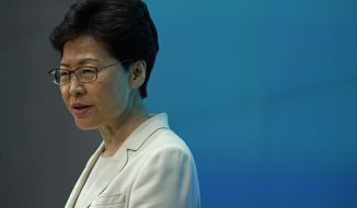 Hong Kong Chief Executive Carrie Lam speaks during a press conference at the Legislative Council in Hong Kong, Tuesday, June 18, 2019. Hong Kong leader apologizes for her handling of unpopular extradition bill, says the city needs hope. (AP Photo/Vincent Yu)