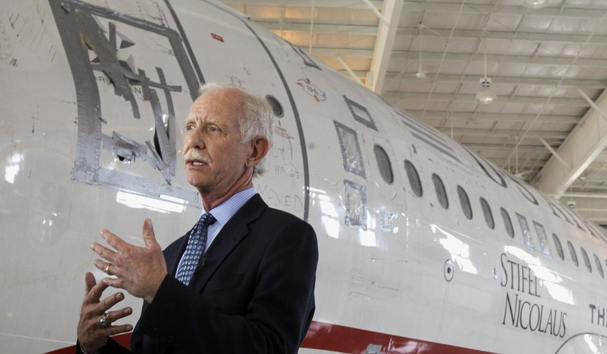 """In this June 11, 2011, file photo, former Capt. Chesley """"Sully"""" Sullenberger talks to the media in front of the US Airways flight 1549 aircraft at the Carolina Aviation Museum in Charlotte, N.C. The president of the pilots' union at American Airlines says Boeing made mistakes in its design of the 737 Max and not telling pilots about new flight-control software on the plane. Sullenberger, the captain who safely landed a disabled jetliner on the Hudson River in 2009, is also expected to testify. He has said that Boeing was more focused on protecting its product, the Max, than protecting the people who use it. (AP Photo/Chuck Burton, File)"""