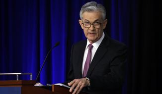 FILE - In this June 2, 2019, file photo Federal Reserve Chairman Jerome Powell speaks at a conference involving its review of its interest-rate policy strategy and communications in Chicago. On Wednesday, June 19, the Federal Reserve releases its latest monetary policy statement and updated economic projections. (AP Photo/Kiichiro Sato, File)