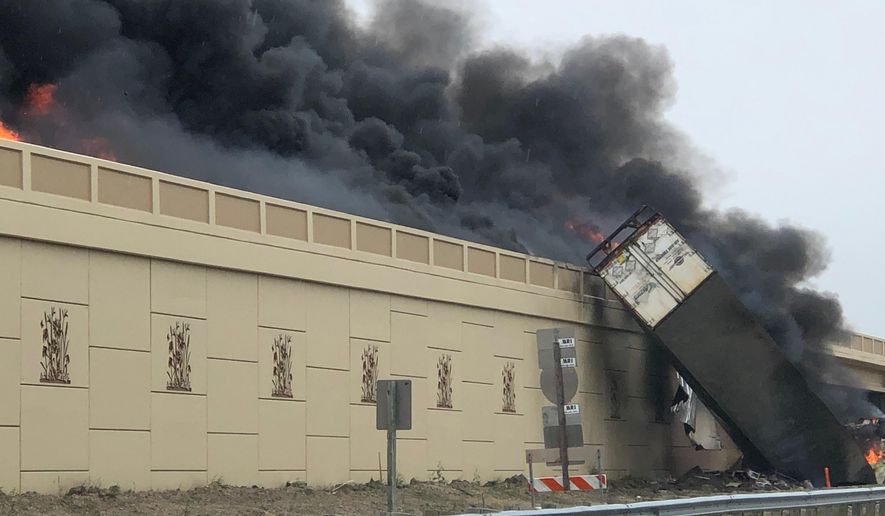 Smoke billows from a semi after a deadly crash on Interstate 94 in Caledonia, Wis, Wednesday, June 19, 2019. Authorities said the semi crashed and exploded and ignited other vehicles on the interstate in southeastern Wisconsin.  (Katelyn Planka via AP)