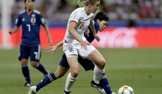 England's Ellen White, front, and Japan's Rikako Kobayashi, right, challenge for the ball during the Women's World Cup Group D soccer match between Japan and England at the Stade de Nice in Nice, France, Wednesday, June 19, 2019. (AP Photo/Claude Paris)