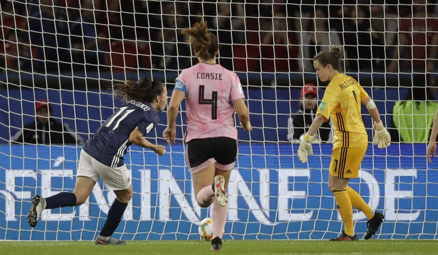 Argentina's Florencia Bonsegundo, left, celebrates after scoring an equaliser goal during the Women's World Cup Group D soccer match between Scotland and Argentina at Parc des Princes in Paris, France, Wednesday, June 19, 2019. Bonsegundo scored in the extra time and the match ended in a 3-3 draw. (AP Photo/Alessandra Tarantino)