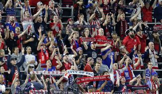 U.S. fans cheer during the second half of the team's CONCACAF Gold Cup soccer match against Guyana on Tuesday, June 18, 2019, in St. Paul, Minn. (AP Photo/Andy Clayton-King) ** FILE **