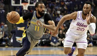 In this March 23, 2019, file photo, Memphis Grizzlies guard Mike Conley (11) handles the ball against Minnesota Timberwolves guard Josh Okogie (20) in the first half of an NBA basketball game, in Memphis, Tenn. A person with knowledge of the decision says the Memphis Grizzlies have traded veteran point guard Mike Conley, who has played the most games in franchise history, to the Utah Jazz. The person says the Grizzlies swapped Conley for Jae Crowder, Kyle Korver and Grayson Allen. The person spoke to The Associated Press Wednesday, June 19, 2019, on condition of anonymity because neither Memphis nor Utah has announced the trade.(AP Photo/Brandon Dill, File) **FILE**
