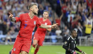 United States' Paul Arriola (7) celebrates after scoring a goal against Guyana goalie Akel Clarke, lower right, during the first half of a CONCACAF Gold Cup soccer match Tuesday, June 18, 2019, in St. Paul, Minn. (AP Photo/Andy Clayton- King)