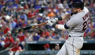 Cleveland Indians' Jason Kipnis follows through on a solo home run swing on a pitch from Texas Rangers relief pitcher Jesse Chavez in the fifth inning of a baseball game in Arlington, Texas, Wednesday, June 19, 2019. (AP Photo/Tony Gutierrez)