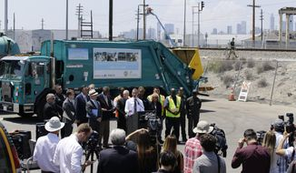 Los Angeles Mayor Eric Garcetti, at podium, surrounded by city officials and LA Sanitation and Environment employees, addresses the city's homelessness problem at a news conference in Los Angeles Wednesday, June 19, 2019. The two-term Democrat who not long ago flirted with a presidential run has been besieged by complaints about homeless encampments that have gotten so widespread he's facing a potential recall campaign. The low-key mayor who in 2016 helped convince voters to borrow $1.2 billion to construct housing for the homeless has found himself forced to explain why the problems have only gotten worse. (AP Photo/Damian Dovarganes)