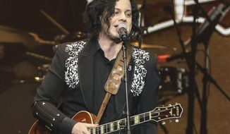 "FILE - This April 1, 2019 file photo shows Jack White performing at Loretta Lynn's 87th Birthday Tribute in Nashville, Tenn. The new album, ""Help Us Stranger"" is set to be released Friday, June 21, 2019. (Photo by Al Wagner/Invision/AP, File)"