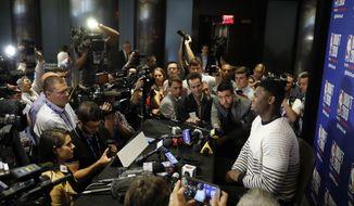 Zion Williamson, a freshman basketball player from Duke, attends the NBA Draft media availability, Wednesday, June 19, 2019, in New York. The basketball draft will be held Thursday, June 20. (AP Photo/Mark Lennihan)