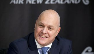 FILE - In this Aug. 29, 2013, file photo, Air New Zealand CEO Christopher Luxon smiles at a media briefing for the Air New Zealand annual result announcement in Auckland, New Zealand.  Luxon says he's resigning after seven years leading the national carrier. Many have speculated he has political ambitions. Luxon says he will take time to reflect and his future options include nonprofits and politics. (AP Photo/New Zealand Herald, Sarah Ivey)