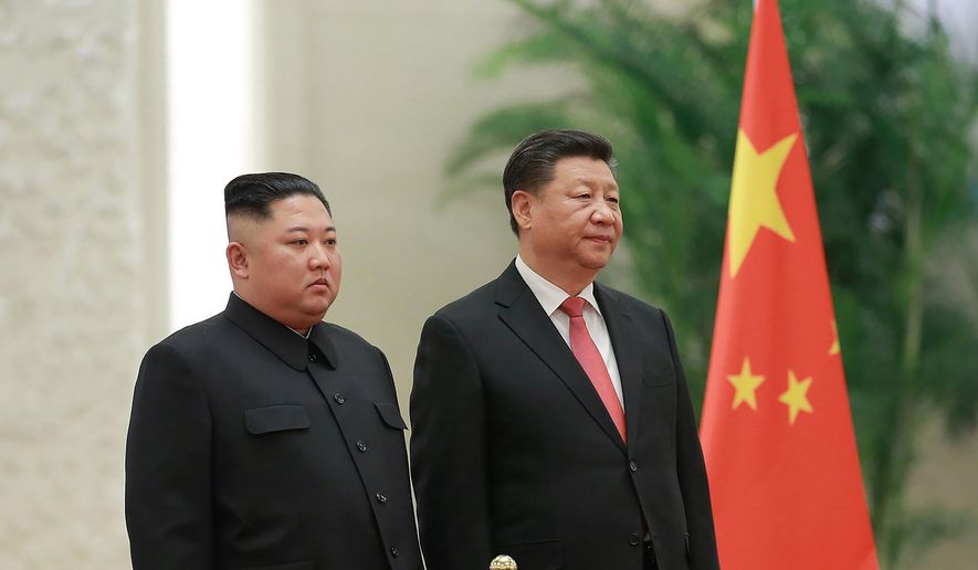 "In this Jan. 8, 2019, file photo provided by the North Korean government, North Korean leader Kim Jong-un, left, and Chinese President Xi Jinping attend a welcome ceremony at the Great Hall of the People in Beijing. Xi said North Korea is taking the ""right direction"" by politically resolving issues on the Korean Peninsula in a rare op-ed published by a North Korean state newspaper Wednesday, June 19, 2019, a day before Xi visits Pyongyang to meet Kim. (Korean Central News Agency/Korea News Service via AP, File)"