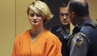 Denali Brehmer, 18, appears in a Superior courtroom for her arraignment in the Nesbett Courthouse on Tuesday, June 18, 2019 in Anchorage, Alaska. Brehmer, 18, now faces four federal child pornography charges in addition to state murder charges in the slaying of Cynthia Hoffman. Hoffman was taken to the Thunderbird Falls trailhead in Chugiak where she was bound with duct tape, shot and left in the Eklutna River on June 2, according to charges.  (Bill Roth/Anchorage Daily News via AP)