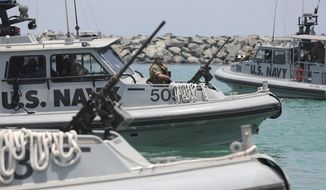 U.S. Navy patrol boats carrying journalists to see damaged oil tankers leave a U.S. Navy 5th Fleet base near Fujairah, United Arab Emirates, Wednesday, June 19, 2019. (AP Photo/Kamran Jebreili) ** FILE **