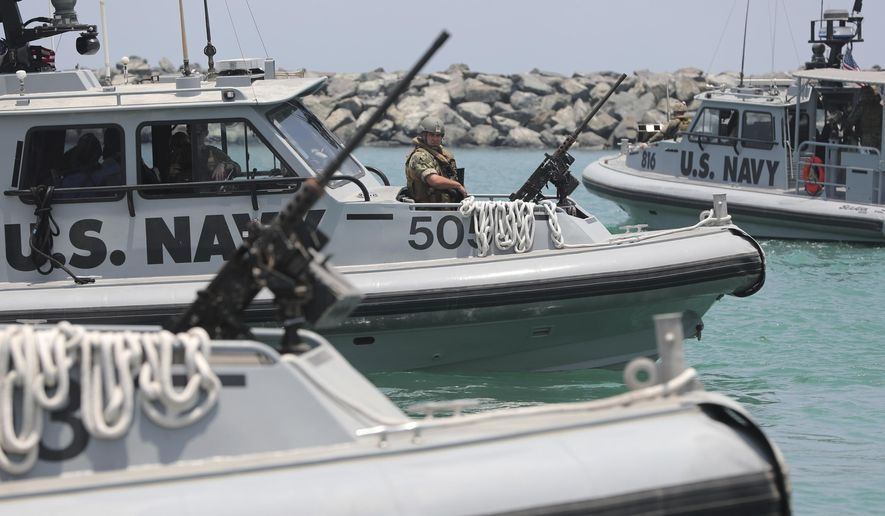 "U.S. Navy patrol boats carrying journalists to see damaged oil tankers leaves a U.S. Navy 5th Fleet base near Fujairah, United Arab Emirates, Wednesday, June 19, 2019. The limpet mines used to attack a Japanese-owned oil tanker near the Strait of Hormuz bore ""a striking resemblance"" to similar mines displayed by Iran, a U.S. Navy explosives expert said Wednesday. Iran has denied being involved. (AP Photo/Kamran Jebreili)"