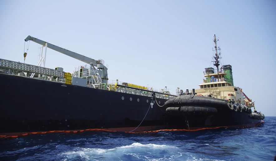 "The Panama-flagged, Japanese-owned oil tanker Kokuka Courageous, which the U.S. Navy says was damaged by a limpet mine, is anchored off Fujairah, United Arab Emirates, during a trip organized by the Navy for journalists, Wednesday, June 19, 2019. The limpet mines used to attack the oil tanker near the Strait of Hormuz bore ""a striking resemblance"" to similar mines displayed by Iran, a U.S. Navy explosives expert said Wednesday. Iran has denied being involved. (AP Photo/Fay Abuelgasim)"