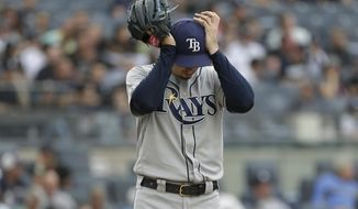 Tampa Bay Rays starting pitcher Blake Snell reacts during the first inning of a baseball game against the New York Yankees at Yankee Stadium, Wednesday, June 19, 2019, in New York. (AP Photo/Seth Wenig)