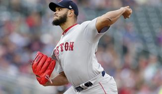 Boson Red Sox pitcher Eduardo Rodriguez throws to a Minnesota Twins batter the first inning of a baseball game Wednesday, June 19, 2019, in Minneapolis. (AP Photo/Andy Clayton-King)