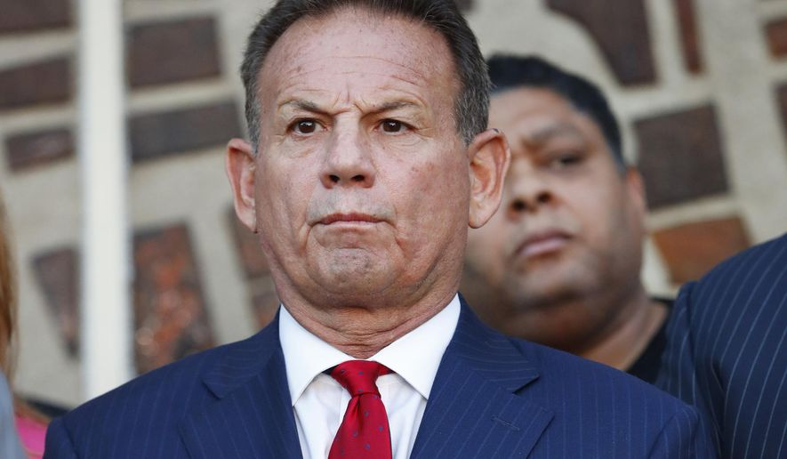 In this Jan. 11, 2019, photo, suspended Broward County Sheriff Scott Israel listens to comments by his attorney at a news conference after new Florida Gov. Ron DeSantis suspended Israel in Fort Lauderdale, Fla., over his handling of February's massacre at Marjory Stoneman Douglas High School. (AP Photo/Wilfredo Lee) **FILE**