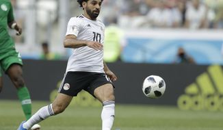 FILE - In this June 25, 2018, file photo, Egypt's Mohamed Salah chases the ball during the group A match between Saudi Arabia and Egypt at the 2018 soccer World Cup at the Volgograd Arena in Volgograd, Russia.  Salah's status as the main attraction at the African Cup of Nations in his home country of Egypt threatens to be overshadowed by yet another soccer corruption scandal. (AP Photo/Andrew Medichini, File)