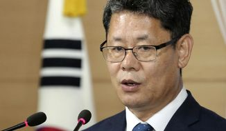 South Korean Unification Minister Kim Yeon-chul speaks during a press conference at the government complex in Seoul, South Korea, Wednesday, June 19, 2019. South Korea says it plans to send 50,000 tons of rice to North Korea through the World Food Program in its second aid package announced over the past month as it looks to help with the North's food shortages and improve bilateral relations. (AP Photo/Ahn Young-joon)