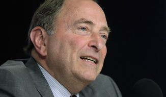 NHL Commissioner Gary Bettman speaks during a news conference before Game 5 of the NHL hockey Stanley Cup Final between the St. Louis Blues and the Boston Bruins, Thursday, June 6, 2019, in Boston, where Dunkin' brands announced a new multi-year agreement partnership with the National Hockey League. (AP Photo/Charles Krupa)