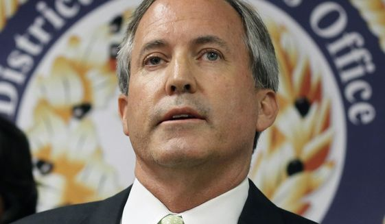 FILE - In this June 22, 2017, file photo, Texas Attorney General Ken Paxton speaks at a news conference in Dallas. Special prosecutors who've spent nearly four years trying to bring Paxton to trial on securities fraud charges are facing another setback, throwing the case into new uncertainty. The Texas Court of Criminal Appeals on Wednesday, June 19, 2019, refused to reconsider a 2018 ruling that effectively denied special prosecutors nearly $200,000 they say they're owed. Prosecutors have threatened to quit if they're not paid. (AP Photo/Tony Gutierrez, File)