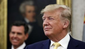 President Donald Trump listens before awarding the Presidential Medal of Freedom to economist Arthur Laffer, Wednesday, June 19, 2019, in the Oval Office of the White House in Washington. (AP Photo/Jacquelyn Martin)