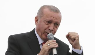 "Turkey's President Recep Tayyip Erdogan, gestures as he talks during a campaign rally in Istanbul for the June 23 re-run of Istanbul elections, Wednesday, June 19, 2019. Erdogan has claimed that former Egyptian President Mohammed Morsi did not die of natural causes but that he was killed. At the campaign speech Erdogan offered as evidence the fact that the deposed president allegedly ""flailed"" in court for 20 minutes and that nobody assisted him. (Presidential Press Service via AP, Pool)"