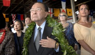 FILE -- This Dec. 7, 2008 file photo shows U.S. Sen. Daniel Inouye in Pearl Harbor, Hawaii during a ceremony commemorating the 67th anniversary of the Japanese attack. The U.S. Navy will christen a new guided missile destroyer the USS Daniel Inouye this weekend during a ceremony in Maine. The Arleigh Burke-class ship is being named after the war hero and politician who broke racial barriers in Congress. (AP Photo/Lucy Pemoni, File)
