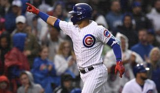Chicago Cubs' Willson Contreras celebrates while running the bases after hitting a solo home run during the third inning of the team's baseball game against the Chicago White Sox on Wednesday, June 19, 2019, at Wrigley Field in Chicago. (AP Photo/Paul Beaty)